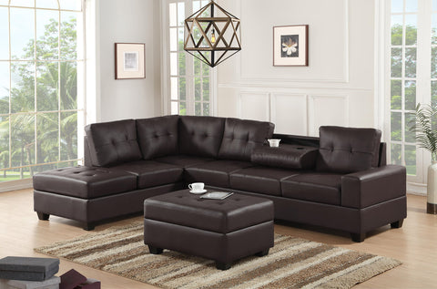 Faux brown leather reversible tufted sectional with drop down cup holders and storage ottoman