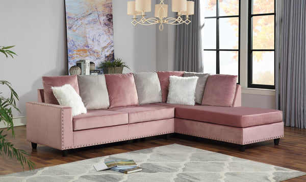 Modern style pink reversible sectional with nailhead trim