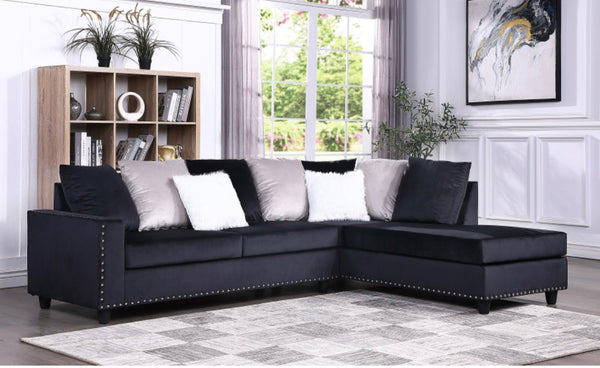 Modern style black reversible sectional with nailhead trim