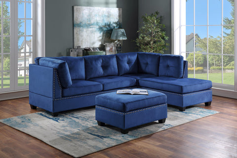 Blue velvet tufted sectional with nailhead accents and ottoman