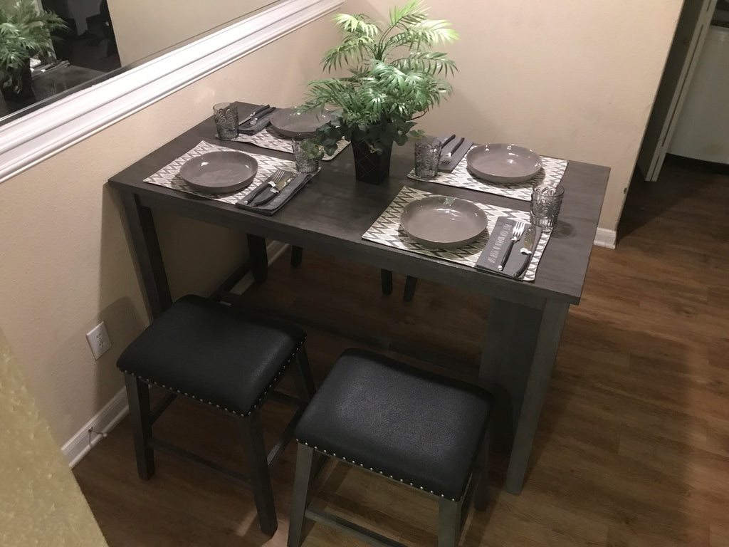Stained grey counterheight storage table with 4 stools