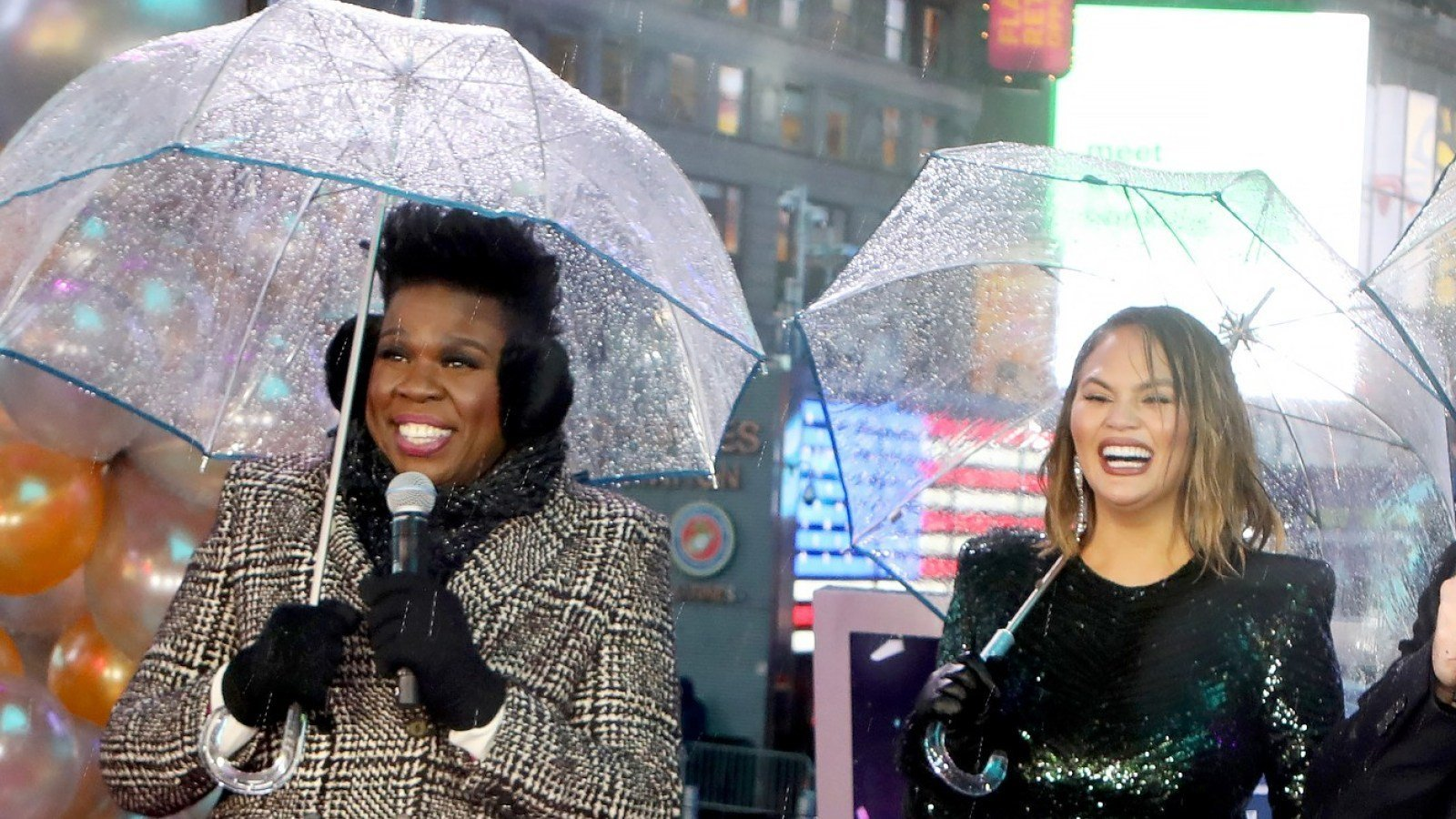 Chrissy Teigen Takes Umbrella To The Eyeball During New Year's Eve Live Broadcast But Shakes It Off Like A Champ