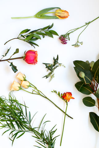 Besteryear Vintage: Eucalyptus pods, Cucculus, Seeded eucalyptus, Olive branches, Yarrow, Podocarpus, Orange roses, Parrot tulips, Freesia, Curly willow