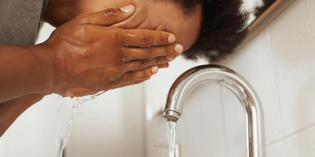 wash face first with warm water