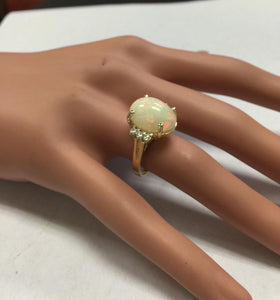 6.30 Carats Natural Impressive Ethiopian Opal and Diamond 14K Solid Yellow Gold Ring