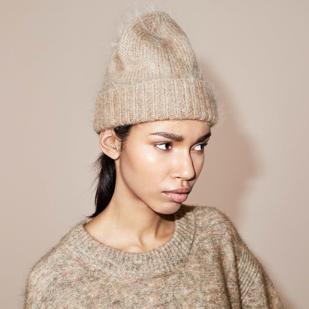FWSS Pacific 202 is a fluffy mohair mix beanie with rib details.