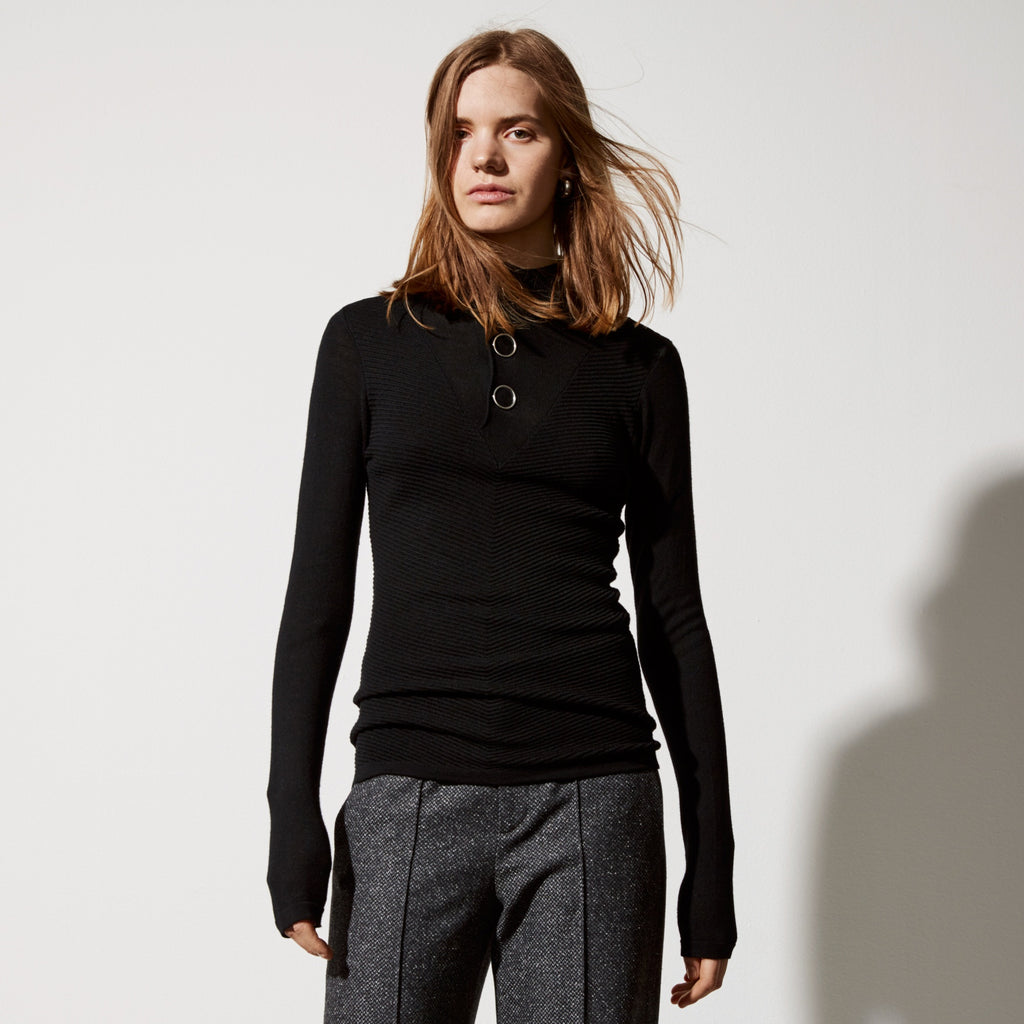 FWSS Night Vision is an ottoman knit merino sweater with a button down mock neck and v-panel detail in front. Features oversized circular snap butt