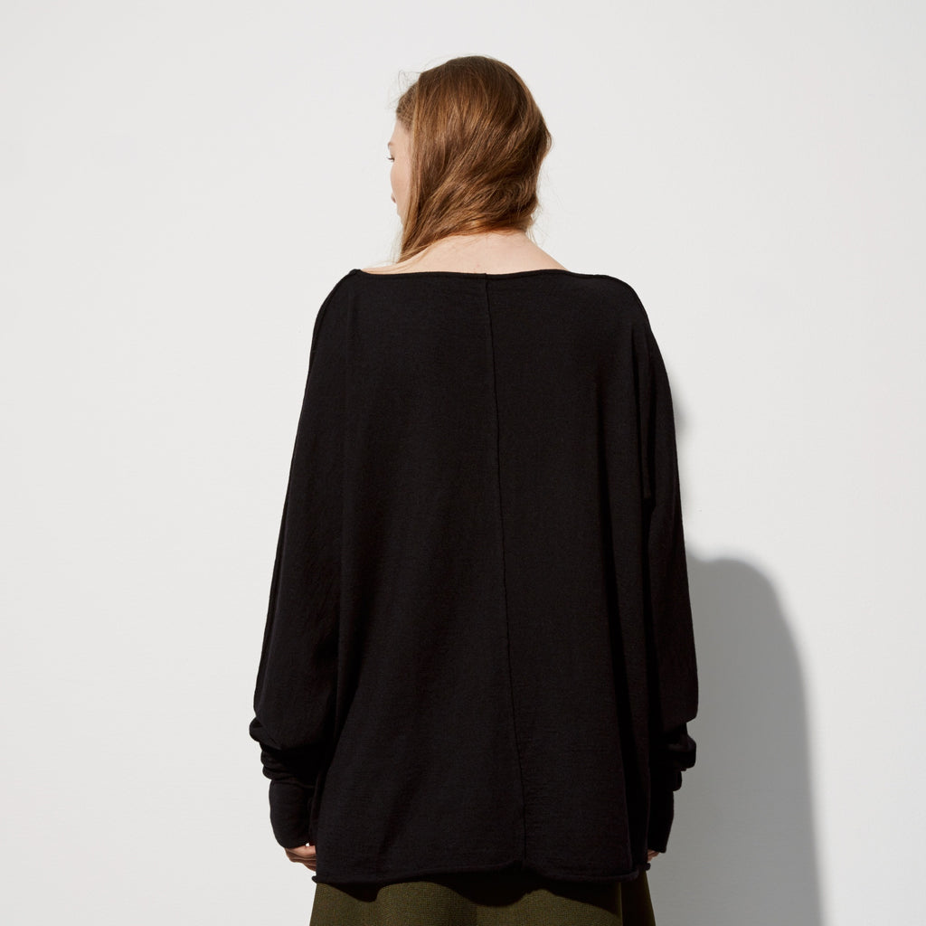 FWSS Peek-A-Boo is an easy round neck wool sweater with raw edge details.
