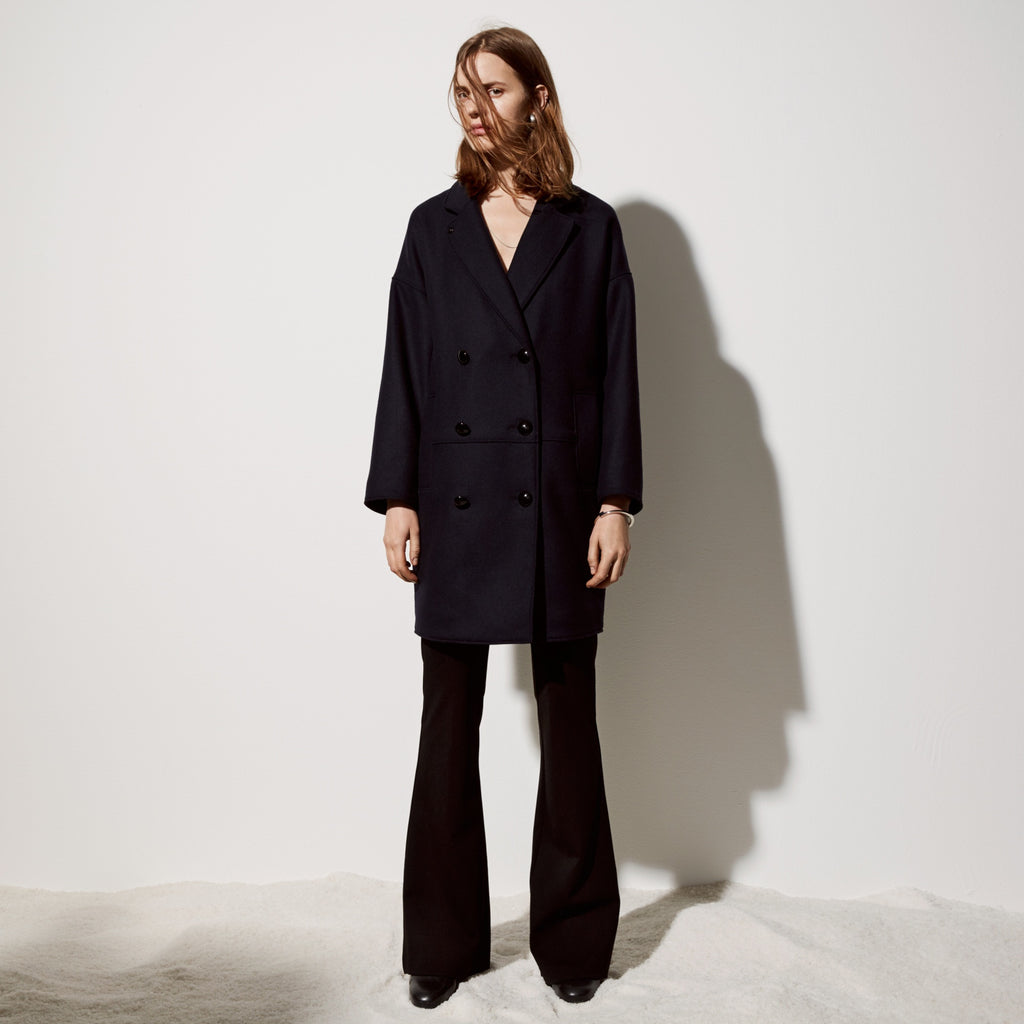 FWSS Red Eye Express is an oversized cocoon double breasted coat with enamelled metal button details and tailored pockets.