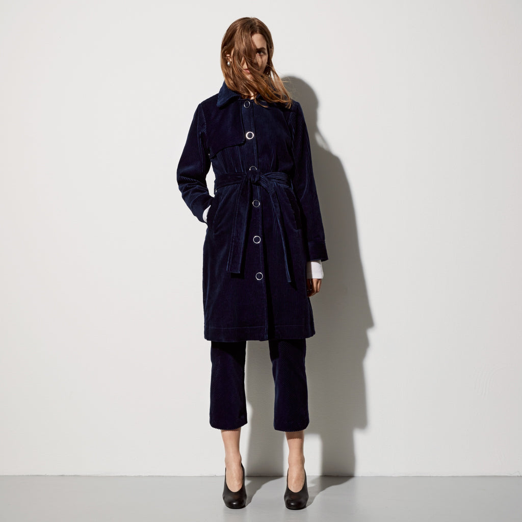 FWSS Secret Agent Man is menswear inspired corduroy trench with chunky oversized ring snaps and removeable collar and waist tie.