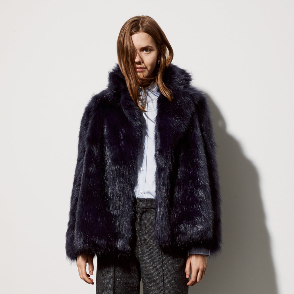 FWSS Smart Patrol is a cropped oversized faux fur jacket with hidden snap buttons and hidden side pockets.