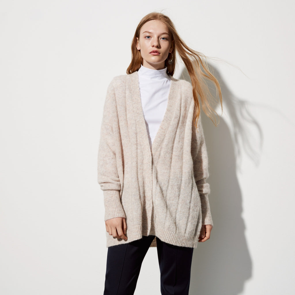 FWSS Timing X is a supersoft mohair/wool mix chunky ribbed v-neck cardigan with invisible snap button closure at front.