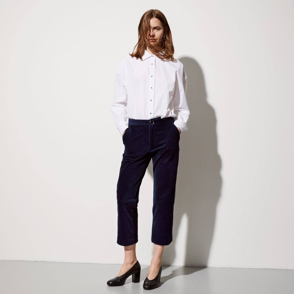FWSS Whip It is a cropped menswear inspired trouser, with side pockets, passepoil pocket in the back and circled button snap closure in front.