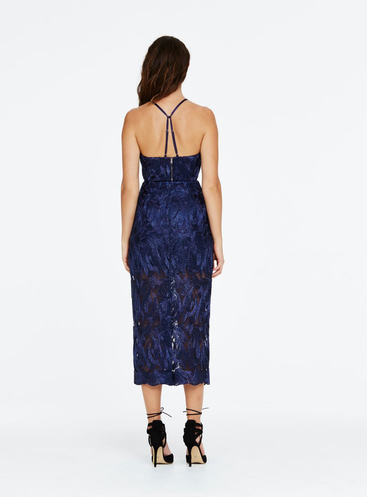 This high waisted midi skirt is a classic shape but constructed of modern lurex lace. Designed to sit at the smallest part of your waist, this style accentuates the feminine shape by curving over the hips and legs to finish at the calves. The skirt is half lined, finishing mid thigh and then sheer to the scalloped hem. To finish the look pair with the 'Wow' crop and wear with heeled sandals.