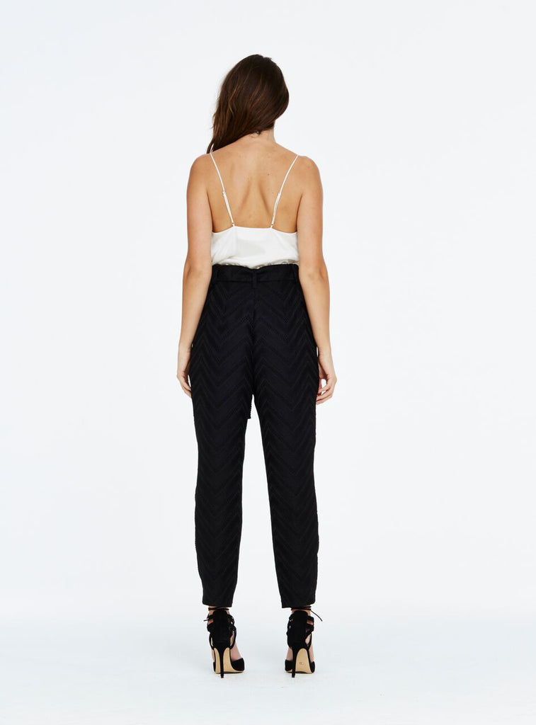The 'This Dance' pant are a classic pair of high waisted, slim leg trousers with a chic tie belt around the waist to cinch in the silhouette. For work or play, this style gives a fresh modern take on a classic wardrobe staple with the zig-zag jacquard fabric and tassel trim detail across the hem of the tie belt feature. Compliment with a classic cotton t-shirt tucked in for a more effortless style or pair with a silk cami for a chic evening look.