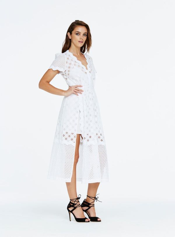 The Day Break dress is a polished style that cinches in at the smallest part of the waist to create a flattering feminine silhouette. Cut from a beautiful 100% cotton broderie anglaise lace, the midi length dress was designed to be worn with the included slip dress underneath and features a centre panel split in the skirt to highlight the length of the legs.