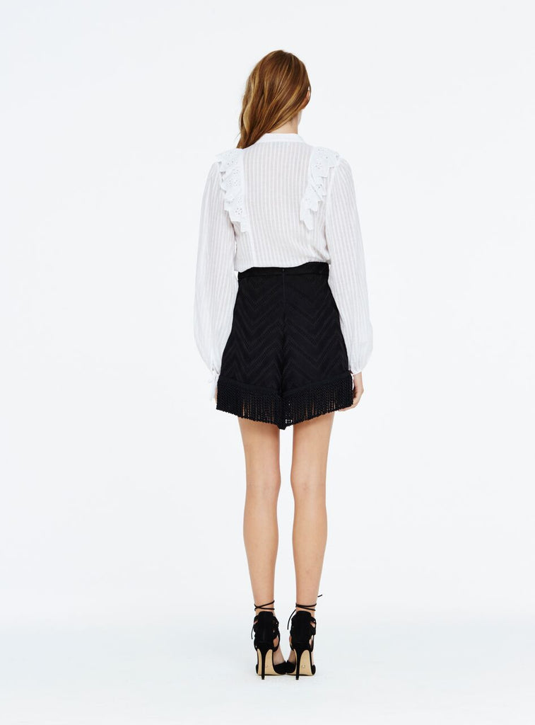 This Alice McCall Empire shirt features a tonal striped design with eyelet ruffles at the shoulders and long blouson sleeves.