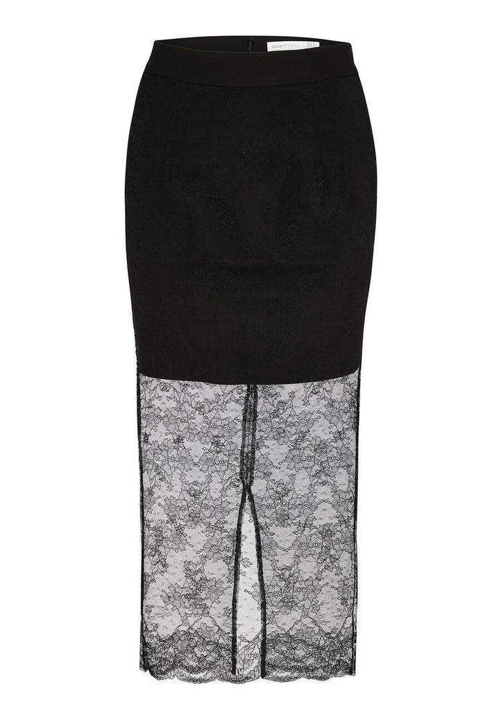 The 'Lyla' skirt is cut from delicate lace that's layered with a skirt slip for coverage and allowing the lower half of the legs to be sheer, showing off the floral lace. This lightweight style has a flattering high-rise waist and scalloped hem. Use this skirt as an easy layering piece and pair with the 'Octavia' top to finish the look. We like it best paired with bold pumps.