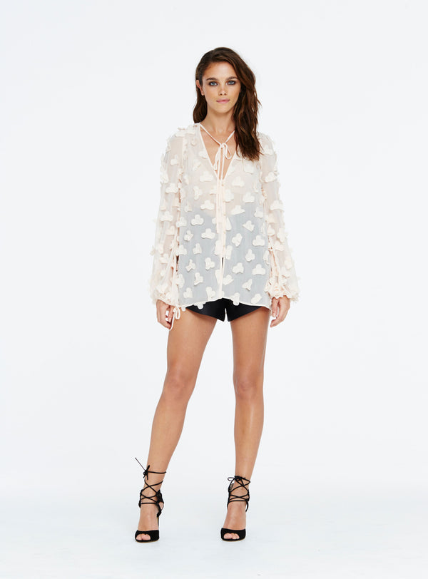 The In Bloom Blouse by Alice McCall features a deep v-neck, long blouson sleeves, button fastenings at front and floral chiffon applique flower petals. This style is unlined.