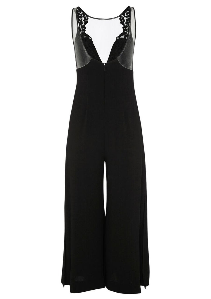 This wide leg jumpsuit gives a flattering lengthening effect on the body, which is enhanced by the plunging neckline. The jumpsuit features a sheer mesh neckline and is finished with lace applique for detail. The back is finished with a bold low scoop backline and the wide leg's open with splits for movement. Wear this style at night with heeled sandals to elongate.