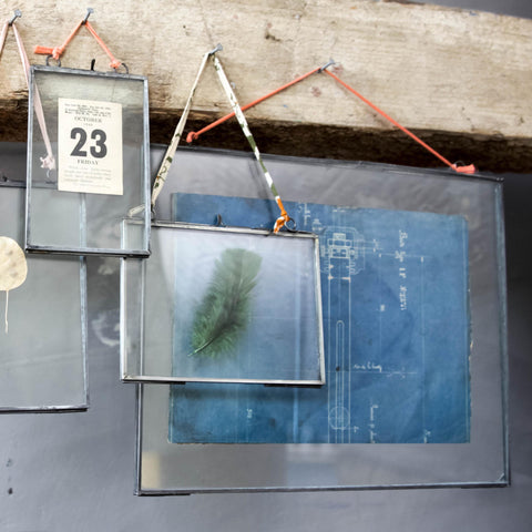 Glass hanging photo frames
