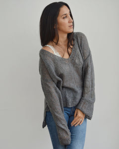 Women wearing knitted grey mohair sweater made using KNIT SAFARI Nebelung Knit pattern