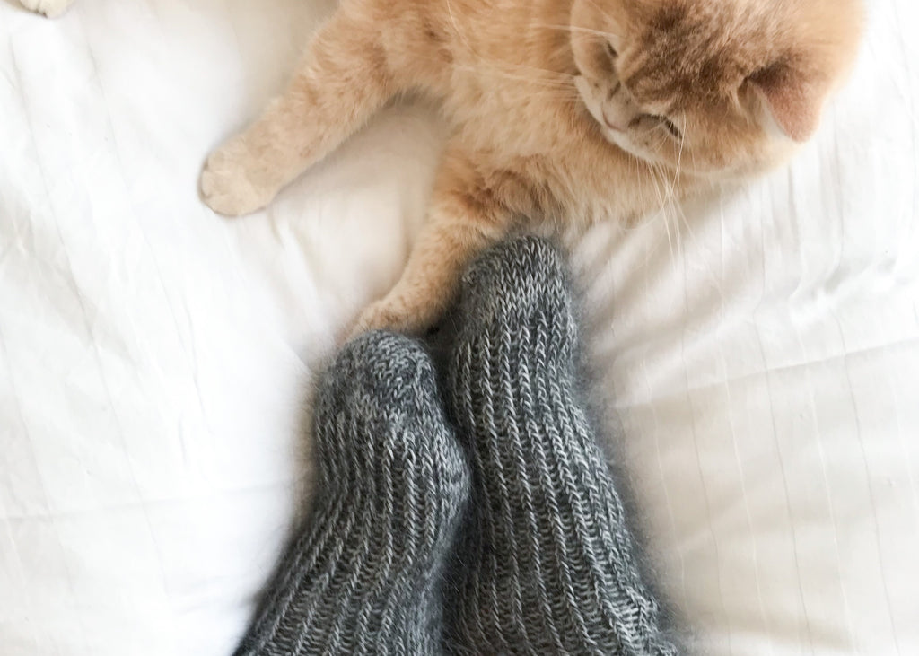 Fluffy grey socks with cream kitten