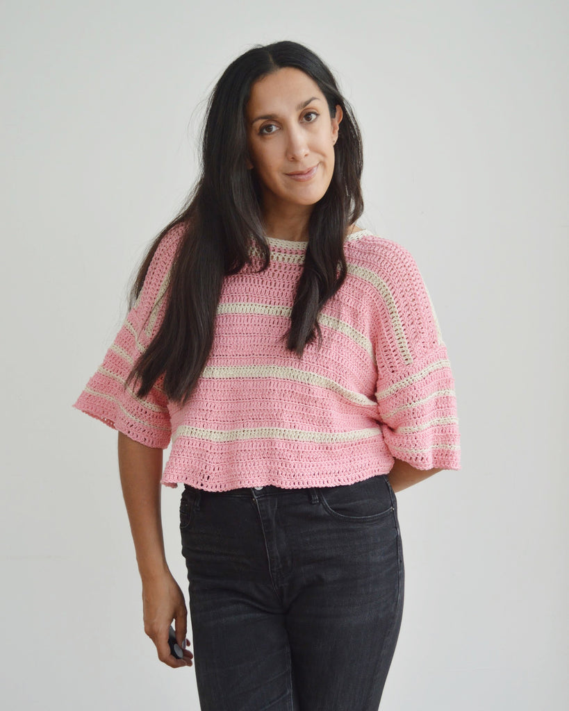 Woman wearing crochet eezy-breezy striped tee in pink and cream