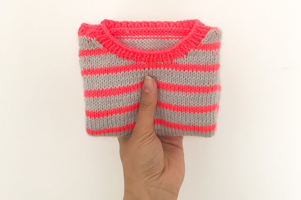 Folded striped baby jumper