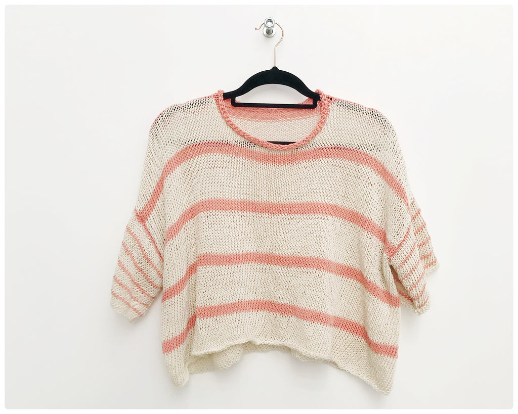 Cream and Peach striped handknitted tee on hanger