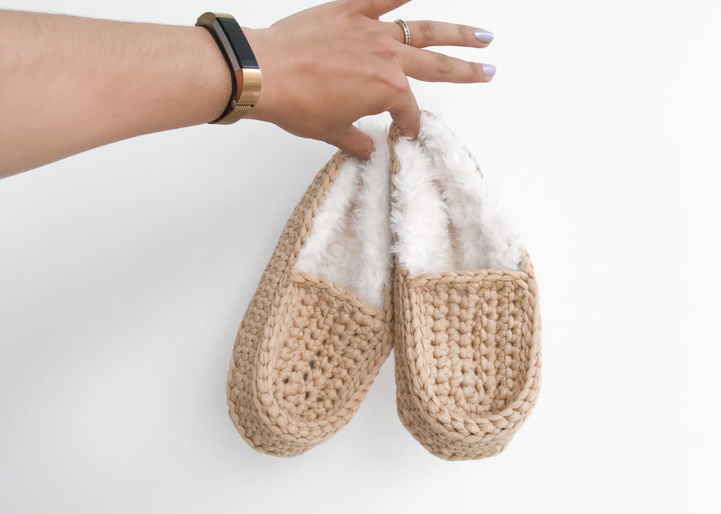 Crochet slippers held in hand