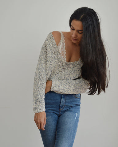 Woman wearing knitted v neck cotton sweater and jeans