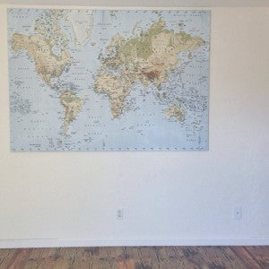 A map of the world: the last item remaining in the Oxenreiders' home, which they have sold prior to their round-the-world trip.