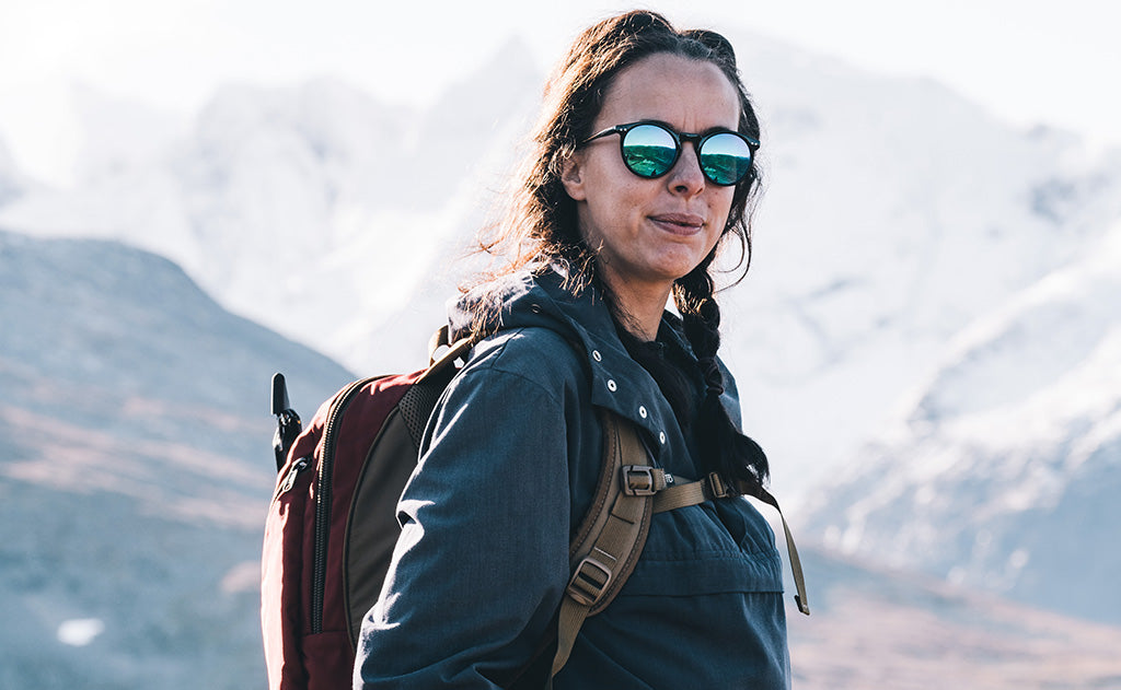 Woman wearing the Guide's Edition Synapse 25 while winter mountaineering and hiking.