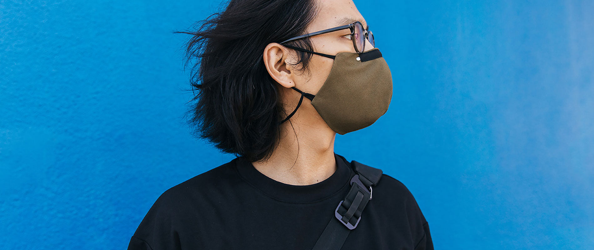 Man wearing a Reusable Cloth Face Mask in Black