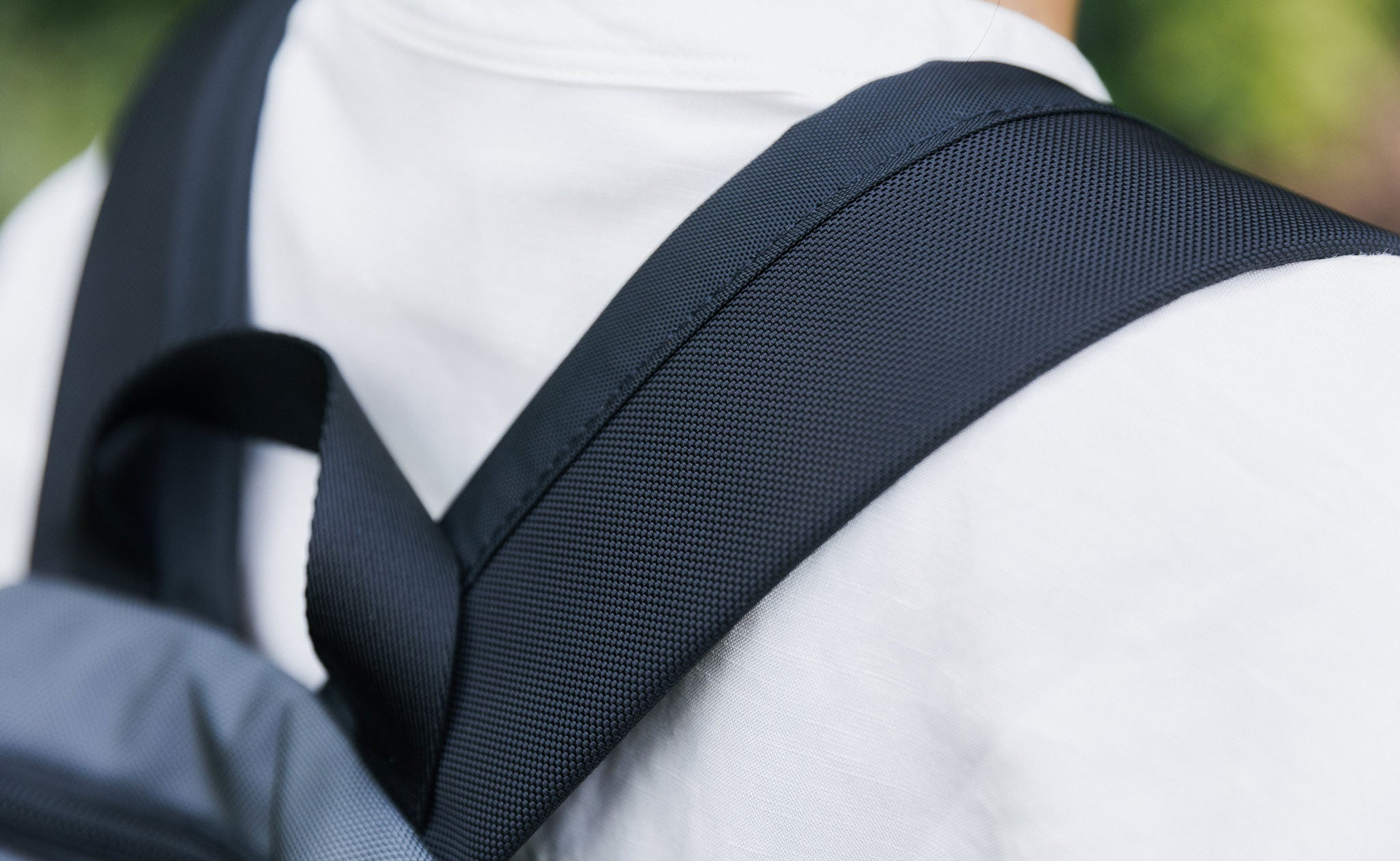 The Contour Backpack Straps of the Paradigm on a person's shoulders