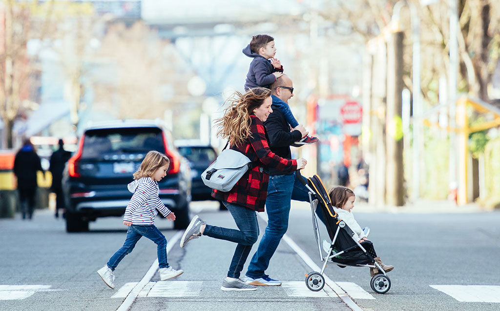 Family crossing the street; mom is wearing a Medium Cafe Bag in Cloud 525d.