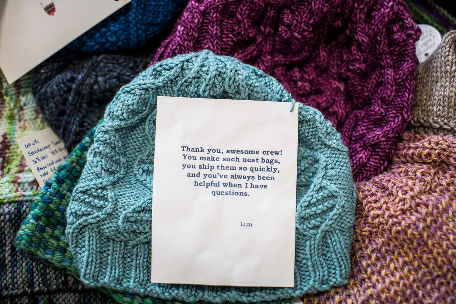 Hand-knitted hats for the TOM BIHN crew made by the TOM BIHN Ravelry Group