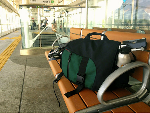 Photo by Jon Geo Camp: TOM BIHN ID messenger bag at train station in Japan