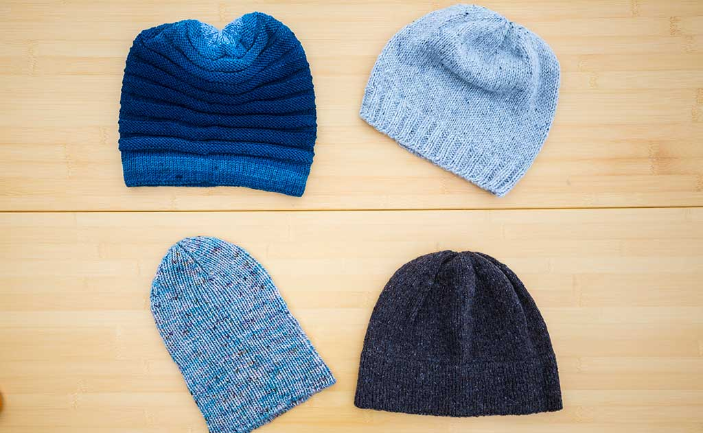 Colorful hats made for the TOM BIHN crew by the Ravelry group