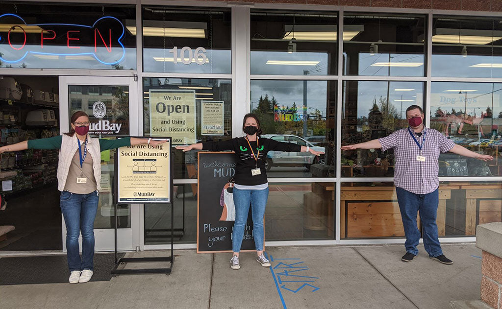 The staff at Mud Bay pet supply stores wearing our Reusable Cloth Face Mask and demo-ing proper distancing.