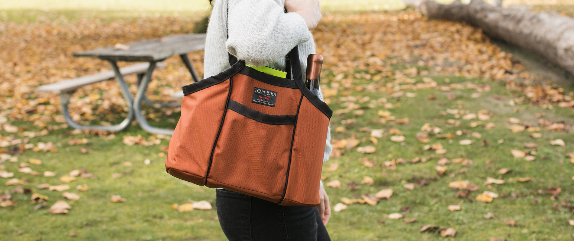 Woman carrying the Pick-Up Truck as a picnic tote on a beautiful fall day.