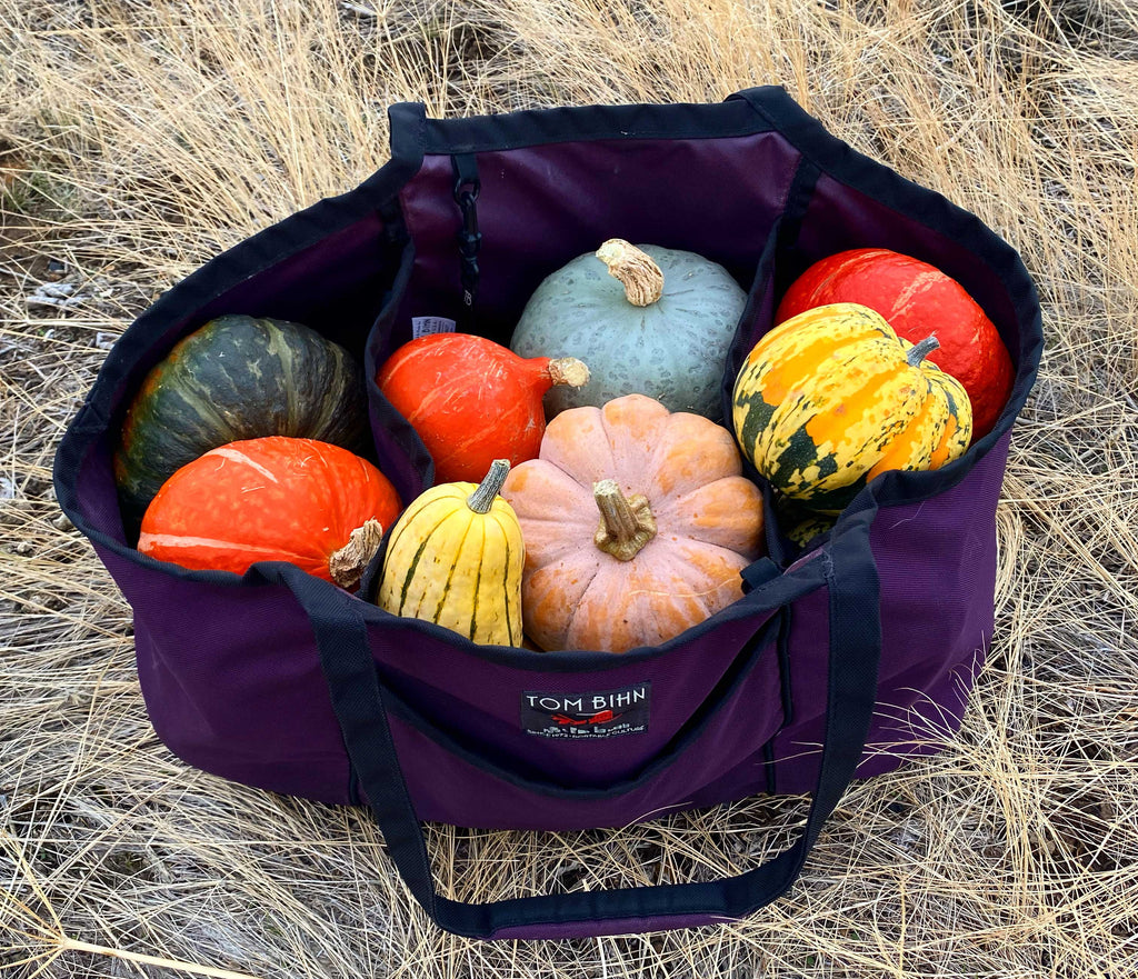 A Monster Truck tote bag in Aubergine filled with 35lbs of winter squash.