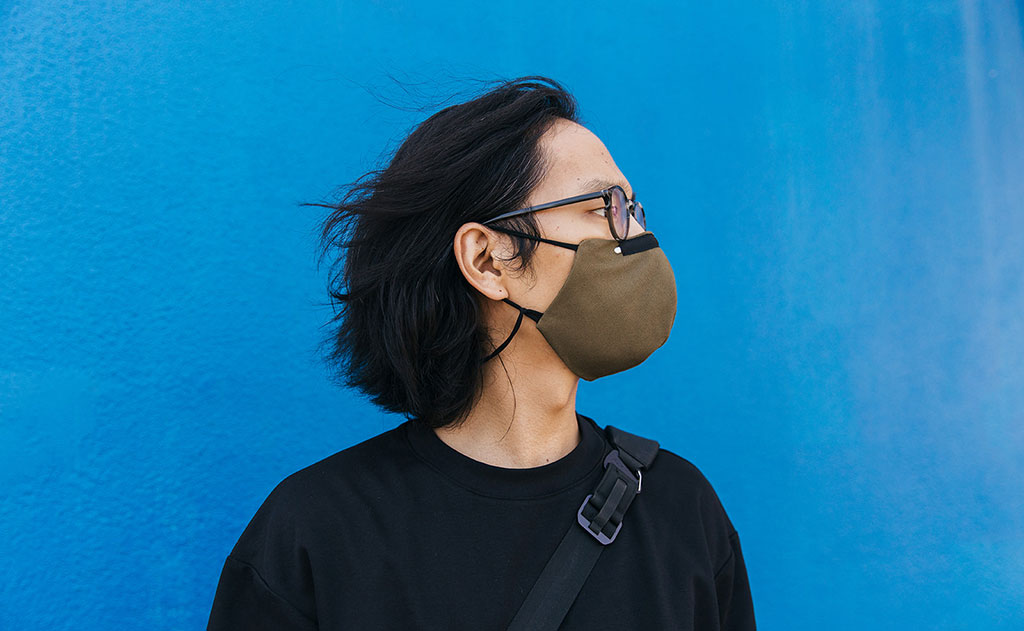 Side profile of a person wearing Olive V2 mask.