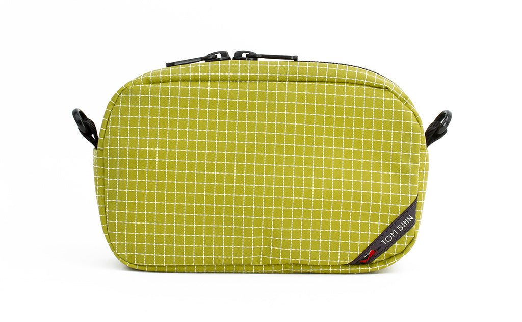 An all-fabric Wasabi green with white grid pattern 3D Organizer Cube.