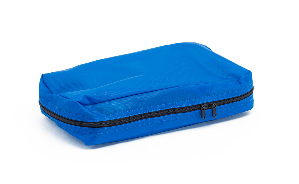 A filled and zipped closed Island (blue) Aether End Pocket Aeronaut 30 Packing Cube.