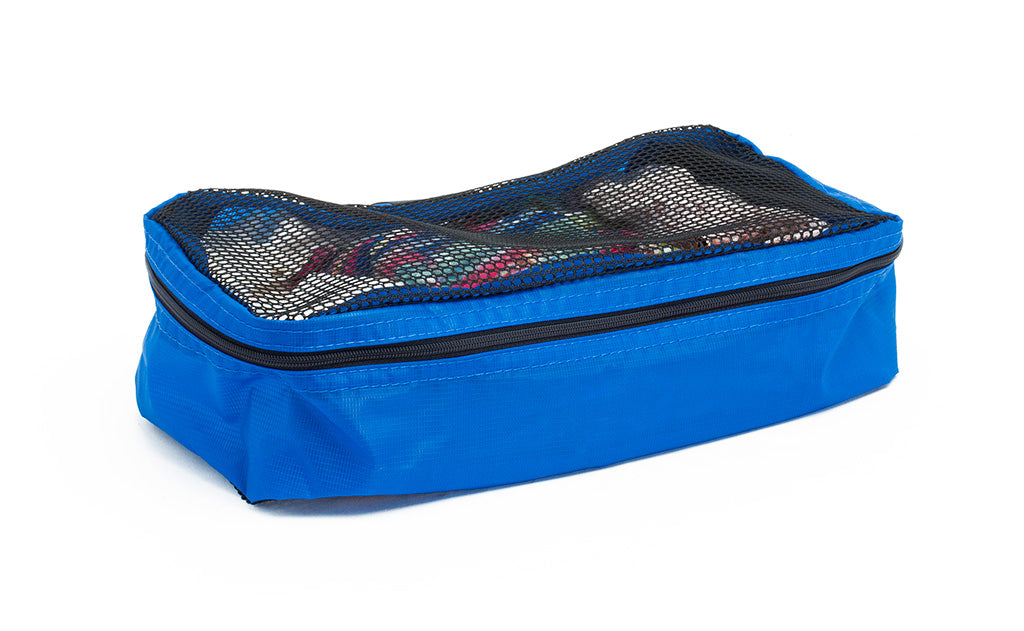 A filled and zipped closed Island (blue) Aether Small Aeronaut 30 Packing Cube.