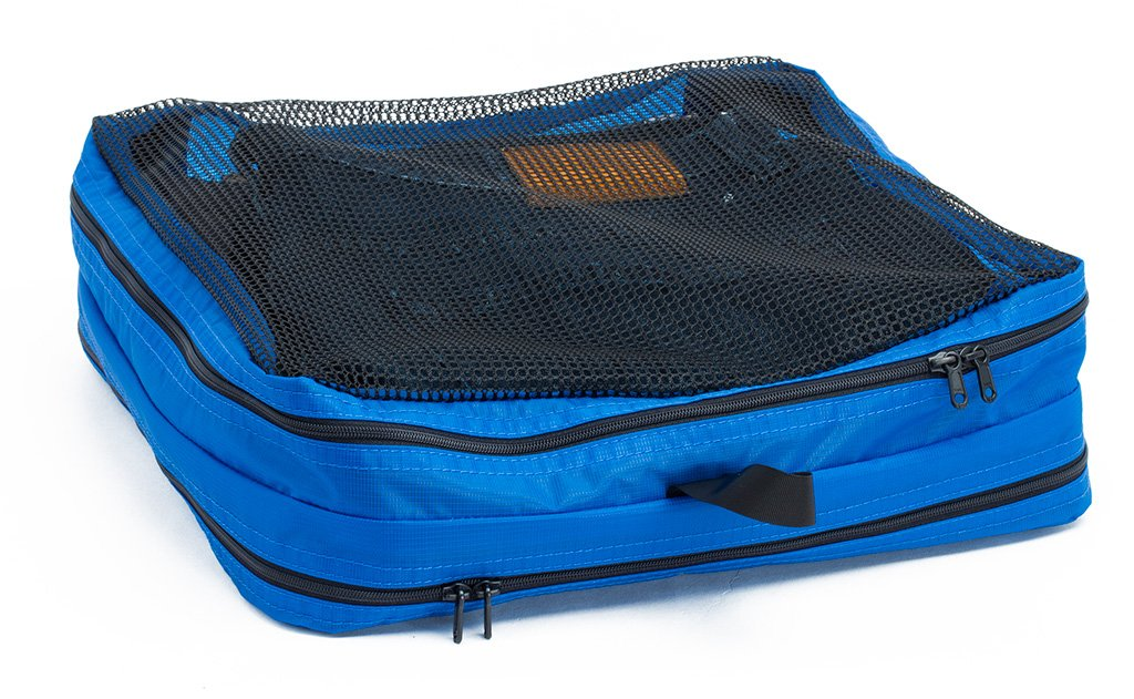 A filled and zipped closed Island (blue) Aether Large Laundry Aeronaut 45 Packing Cube mesh side up.