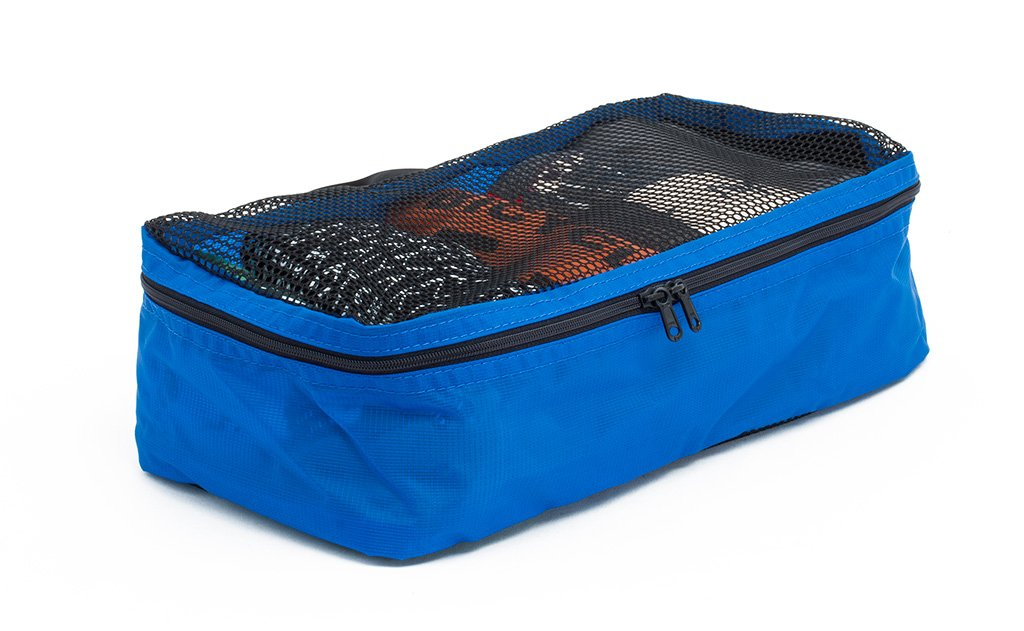 A filled and zipped closed Island (blue) Aether Small Aeronaut 45 Packing Cube.