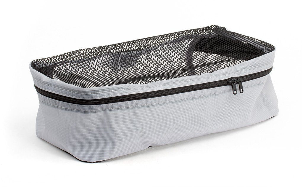 An empty and zipped closed Northwest Sky (light grey) Aether Small Aeronaut 45 Packing Cube.